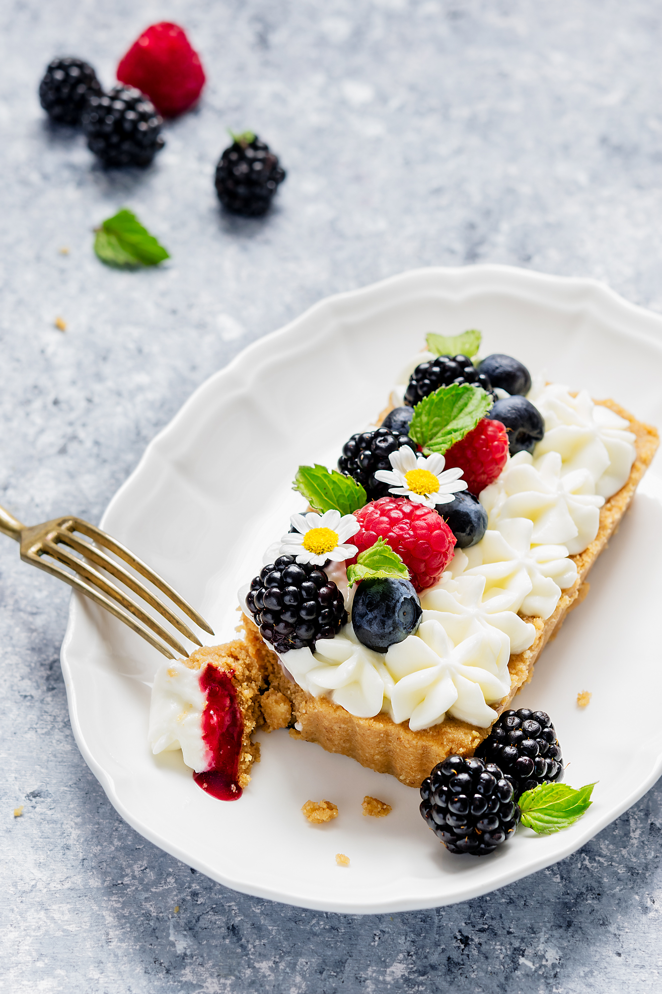 Mini cheesecake tart ai frutti di bosco